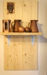 Copper plated 3D print mounted on pinewood board shelf.